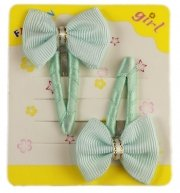 Pair of turquoise hair clips with bow