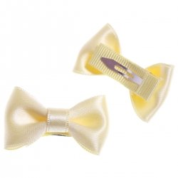 Pair of ivory hair clips with bow